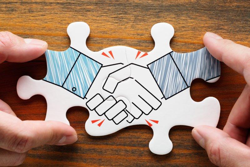 握手しているパズル
